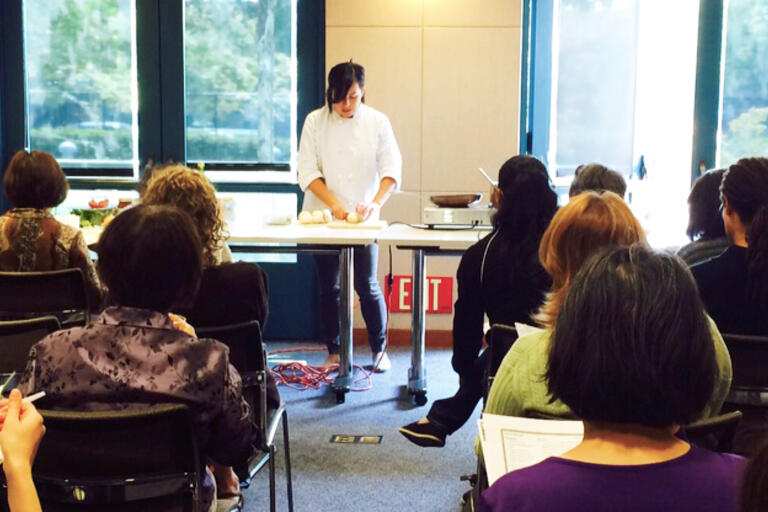 Photo of cooking class with registered dietitian in the front.