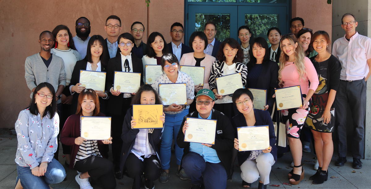 Global Institute Participants pose with certificates