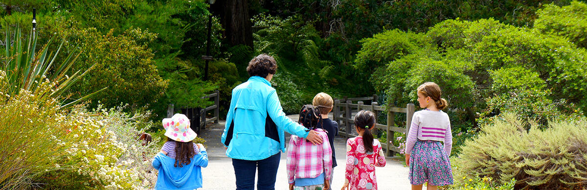 adult with children at uc berkeley's botanical gardens