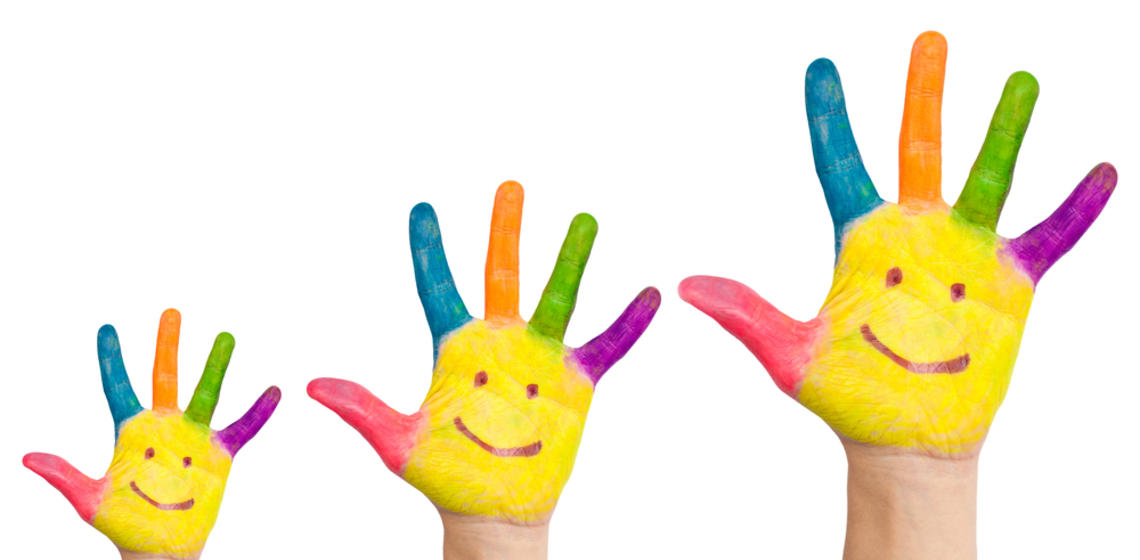 Hands with painted smiley faces