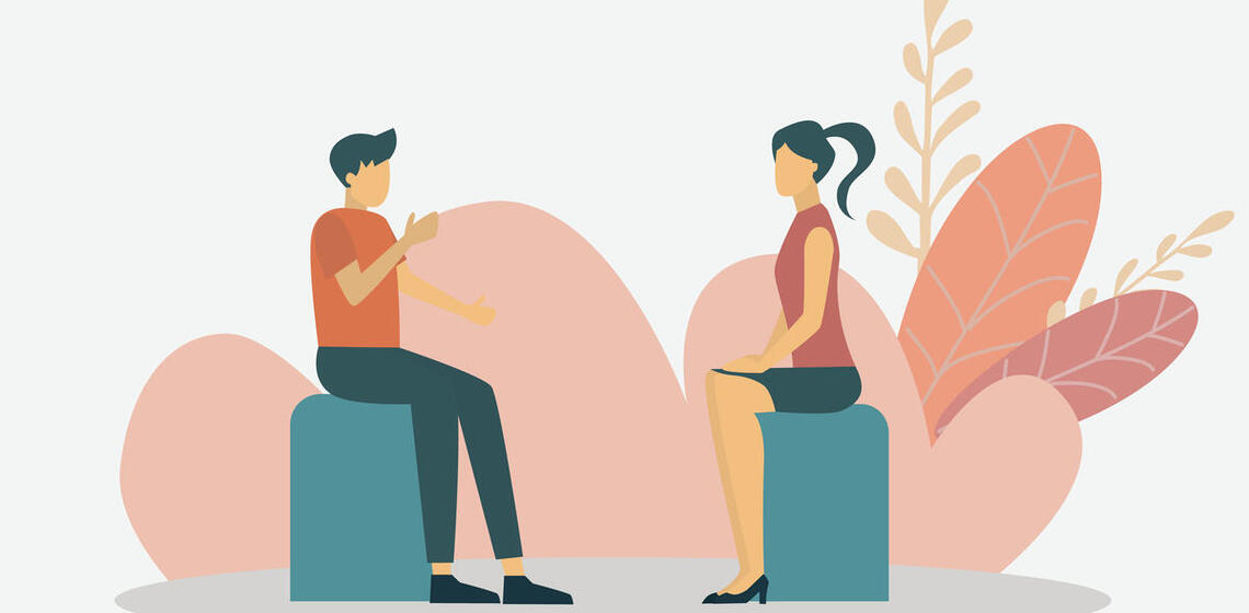 Two people sitting opposite each other on stools, each talking and speaking, being present for each other