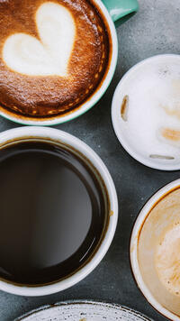 aerial view of various cups of coffee