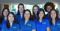 Nutrition Outreach Workers smiling for camera in their blue shirts.