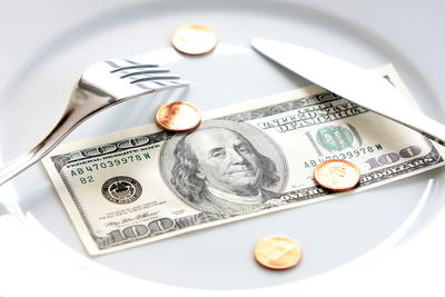 picture of plate with money on it and a fork and knife